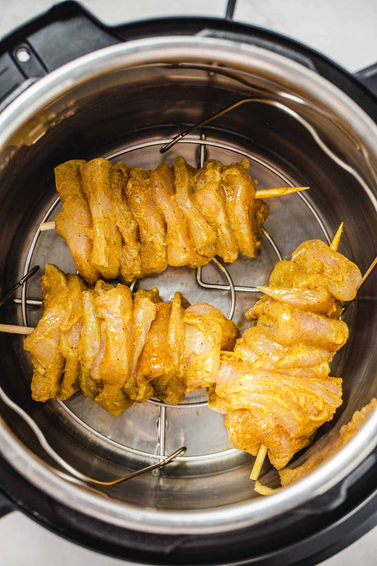 3 chicken shawarma skewers in the Instant Pot before cooking
