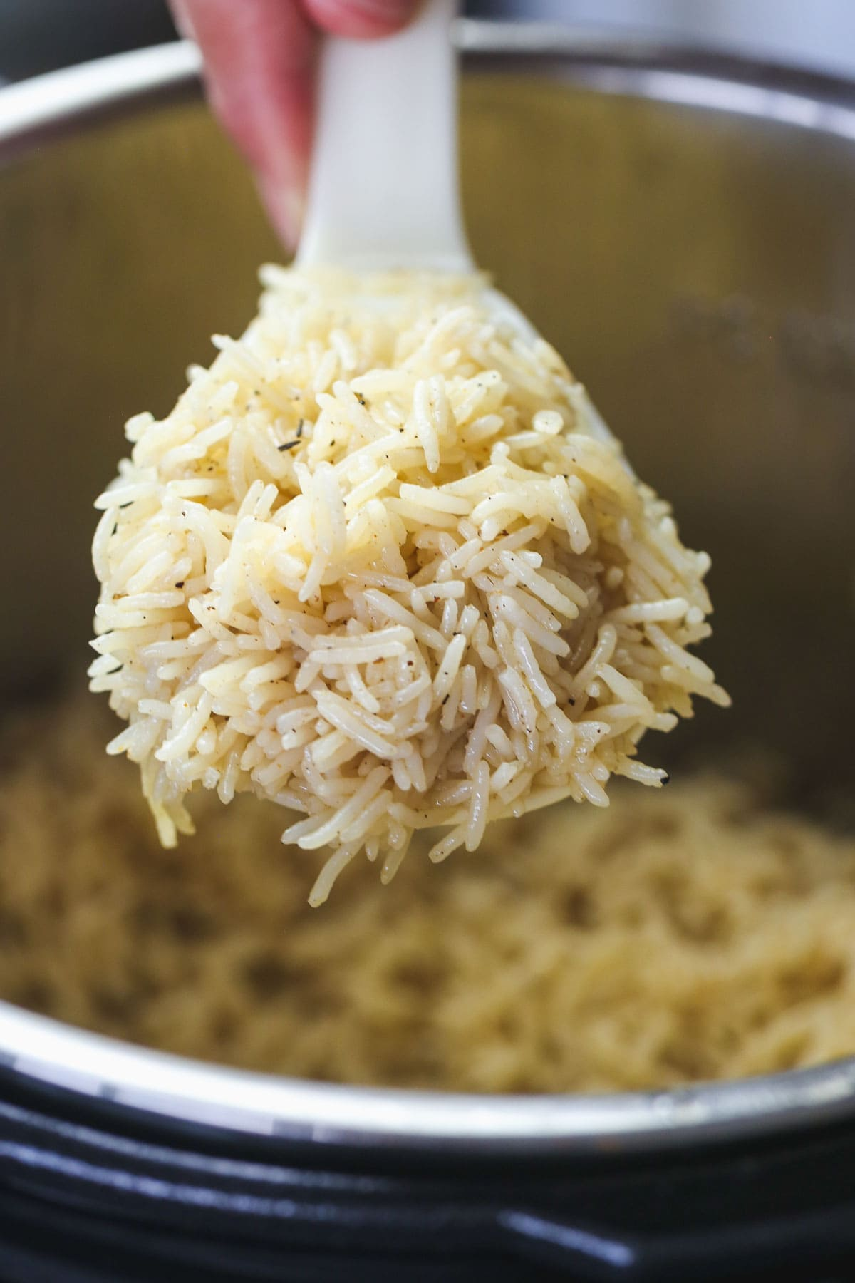 perfectly cooked instant pot rice in a serving spoon